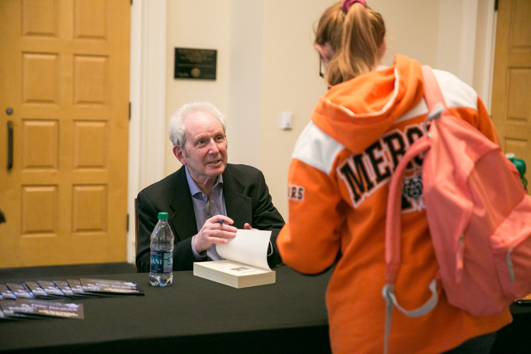 Peter Guralnick signs a book for a Mercer student